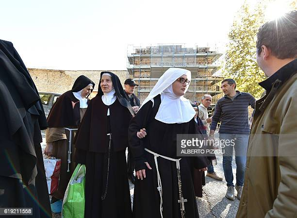 Nuns leave the center of Norcia after a 66 magnitude earthquake on October 30 2016 It came four days after quakes of 55 and 61 magnitude hit the same...