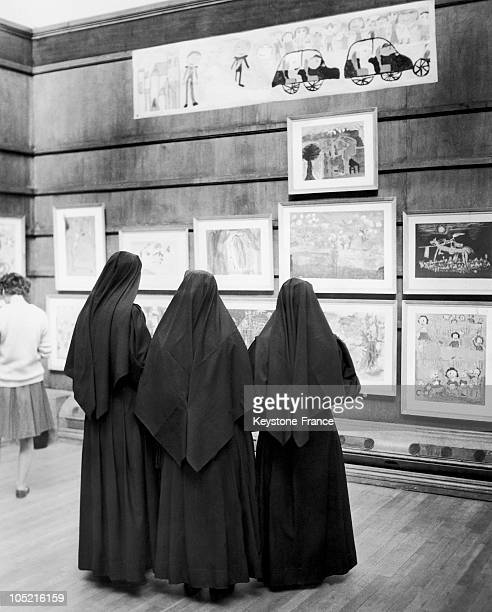 Nuns On An Exhibition Of Children Illustrations
