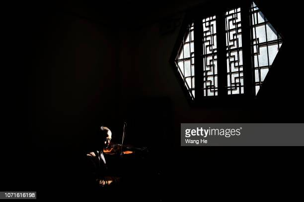 A nuns practices violin in the Tiantai temple on November 22 2018 in Hongan Hubei province Chinamonks of Tiantai Temple are proficient not only in...