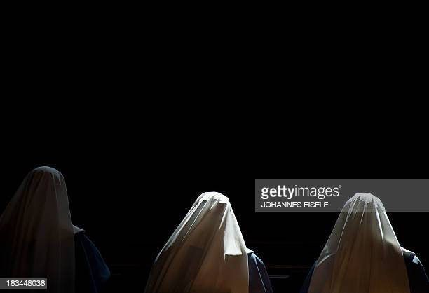 Nuns pray inside St Peter's basilica at the Vatican ahead of the cardinals conclave on March 10 2013 Roman Catholic cardinals from around the world...