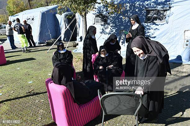 Nuns rest after beeing evacuated from the red zone following a 66 magnitude earthquake on October 30 2016 in Norcia It came four days after quakes of...