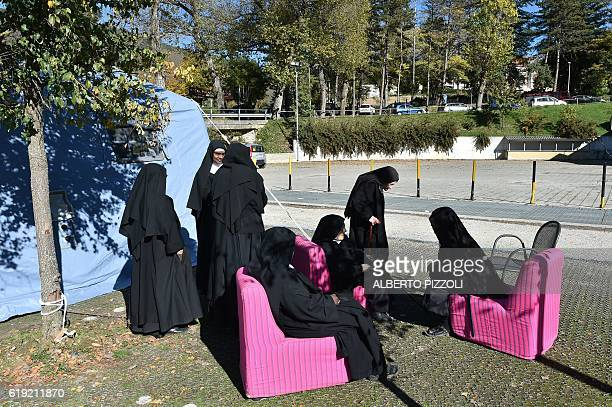 Nuns rest after being evacuated from the red zone following a 66 magnitude earthquake on October 30 2016 in Norcia It came four days after quakes of...