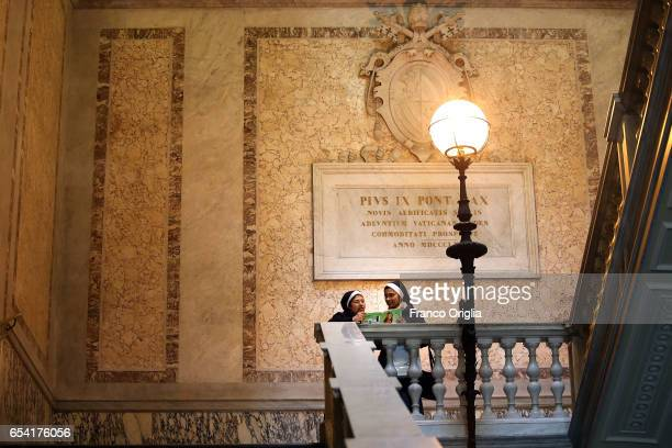 Nuns rest on the staircase to the Cortile di San Damaso of the Apostolic Palace on March 16 2017 in Vatican City Vatican The Apostolic Palace is the...