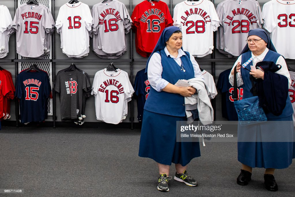 Nuns shop in the team store before a game between the Boston