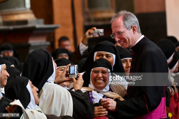 Nuns take pictures with the Master of Pontifical Liturgical Celebrations Monsignor Guido Marini as they await for the arrival of Pope Francis inside...