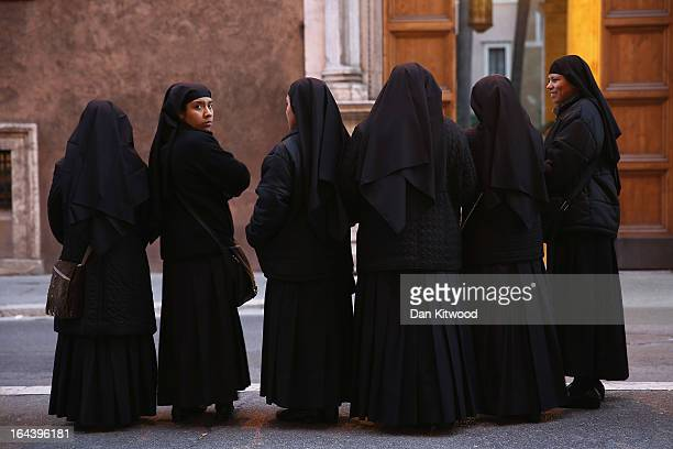 Nuns wait at a bus stop in central Rome on March 23 2013 in Rome Italy Today near Rome Pope Francis and Pope Emeritus Benedict met for a private...