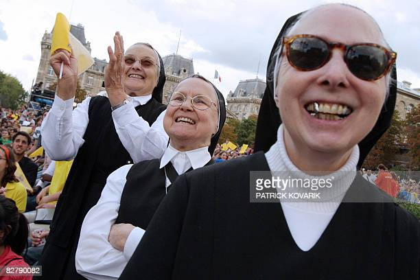 Nuns wait for the arrival of Pope Benedict XVI for an evening prayer service at NotreDame Cathedral on September 12 in Paris during his fourday visit...