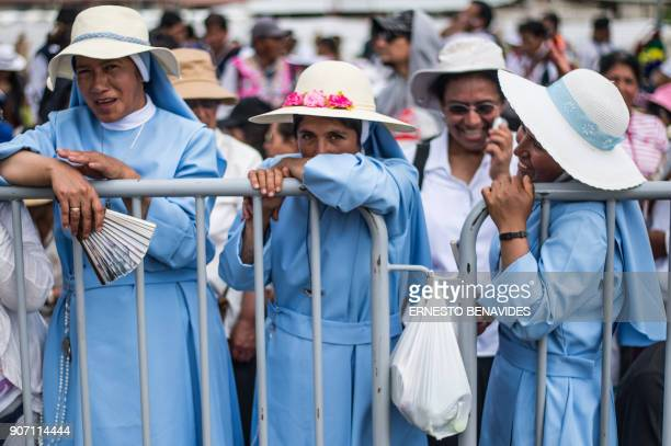 TOPSHOT Nuns wait for the arrival of Pope Francis in the Peruvian city of Puerto Maldonado where the pontiff will meet with representatives of...