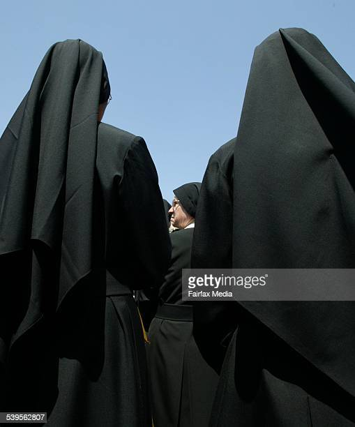 Nuns waiting for the new Pope St Benedict to make his first Sunday blessing from the window of his apartment in the Vatican on 1 May 2005 AFR GENERIC...