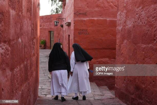 Nuns walk inside the monastery of Santa Catalina in Arequipa The Santa Catalina Monastery UNESCO World Heritage which was founded in 1580 by doña...