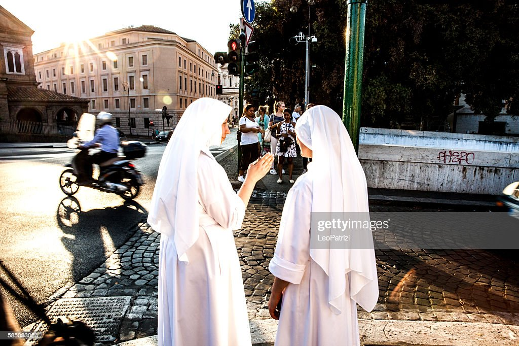 Nuns walking in Central Rome, close to Vatican City : Stock Photo