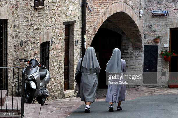 Nuns walking through the Assisi centre on June 13 2009 in Assisi Italy Assisi is a small Umbrian town in central Italy located 12 miles east of...