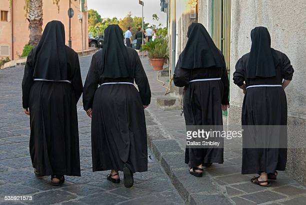 nuns walking to church, in lipari, sicily - nun stock pictures, royalty-free photos & images