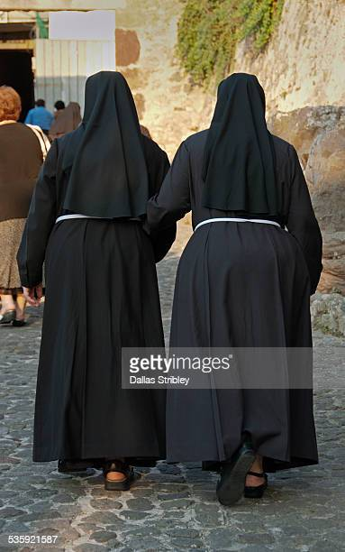 nuns walking to church in lipari, sicily - nun stock pictures, royalty-free photos & images
