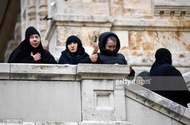 Nuns watch as Prince Charles Prince of Wales visits at the Church of St Mary Magdalene at the Mount of Olives on January 24 2020 in Jerusalem Israel...