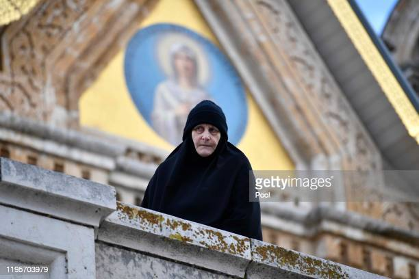 A nuns watches as Prince Charles Prince of Wales visits at the Church of St Mary Magdalene at the Mount of Olives on January 24 2020 in Jerusalem...