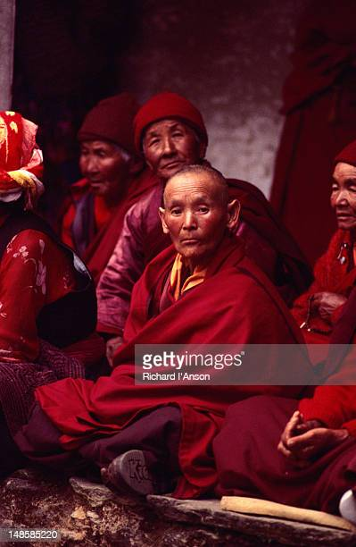 nuns watching the dancing at the mani rimdu festival at chiwang gompa (monastery). - mani rimdu festival stock pictures, royalty-free photos & images