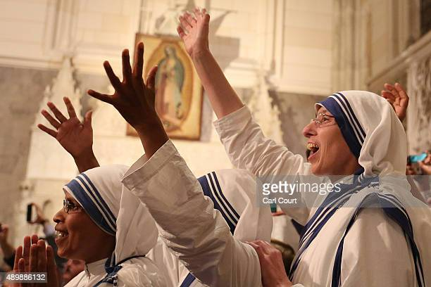 Nuns wave as Pope Francis arrives to lead a service at St Patrick's Cathedral on September 24 2015 in New York City Pope Francis is in New York on a...