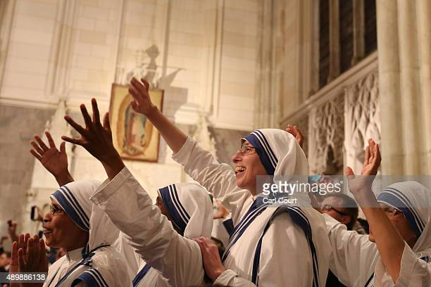 Nuns wave as Pope Francis arrives to lead a service at St Patrick's Cathedral on September 24, 2015 in New York City. Pope Francis is in New York on...