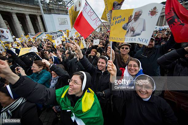 Nuns wave as they gather to watch Pope Benedict XVI deliver his last Angelus Blessing on February 24 2013 in Vatican City Vatican Pope Benedict XVI...