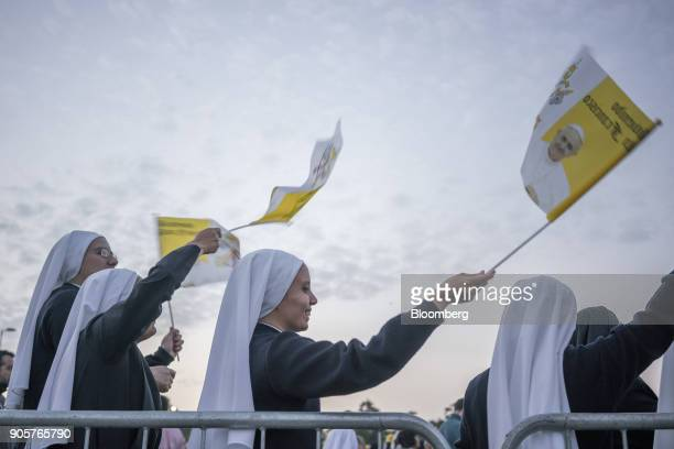 Nuns wave flags before Pope Francis not pictured begins mass at O'Higgins Park in Santiago Chile on Tuesday Jan 16 2018 400000 Chileans attended Pope...
