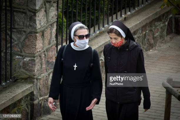 Nuns wearing facial covers ares seen in Warsaw Poland on April 29 2020 The Polish PM Morawiecki on Wednesday announced it will reopen schools and...