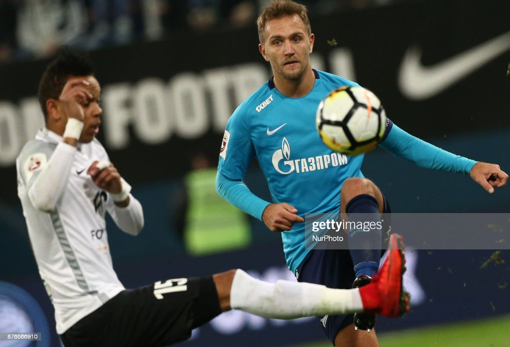 Nunu Rosha (L) of FC Tosno and Domenico Criscito of FC Zenit Saint Petersburg vie for the ball during the Russian Football League match between FC Zenit Saint Petersburg and FC Tosno at Saint Petersburg Stadium on November 19, 2017 in St. Petersburg, Russia.