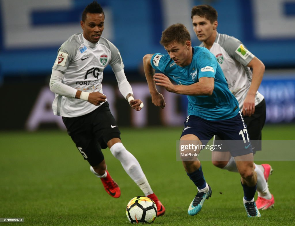 Nunu Rosha (L) of FC Tosno and Oleg Shatov of FC Zenit Saint Petersburg vie for the ball during the Russian Football League match between FC Zenit Saint Petersburg and FC Tosno at Saint Petersburg Stadium on November 19, 2017 in St. Petersburg, Russia.