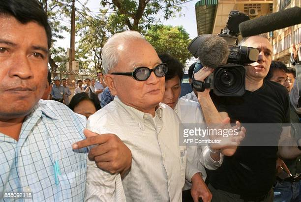 Nuon Chea Brother Number Two in the Khmer Rouge and second in charge after leader Pol Pot is escorted from ambulance to speak as a witness at the...
