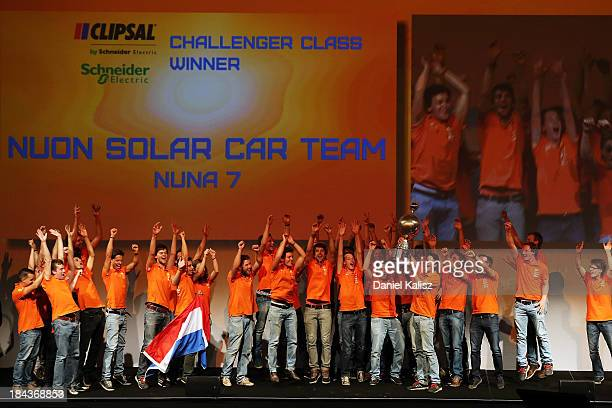 Nuon Solar Car Team, Delft University of Technology from the Netherlands receives the trophy for Challenger Class Winner and outright victory in the...