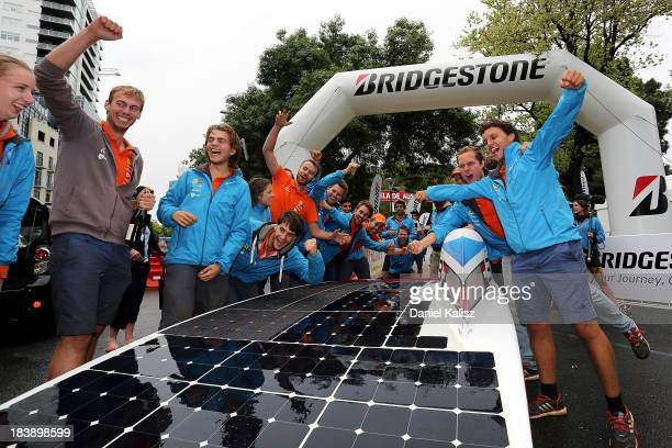 Nuon Solar Team from the Delft University of Technology, Netherlands team members celebrate after taking overall victory and victory in the Schneider...