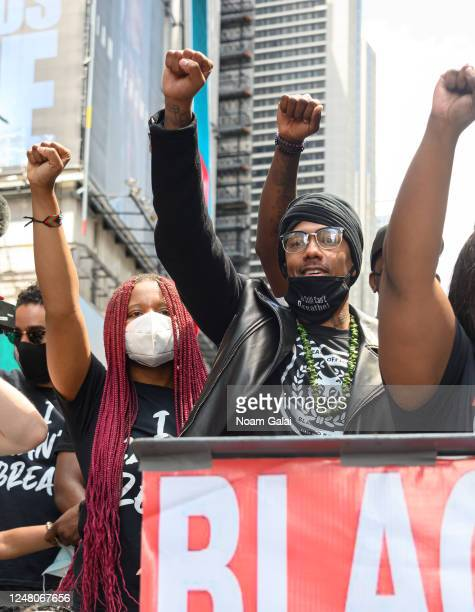 Nupol Kiazolu and Nick Cannon attend a Black Lives Matter rally in Times Square on June 07 2020 in New York New York