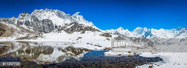Nuptse Lhotse and Makalu 8485m reflecting Himalayan mountain lake Nepal