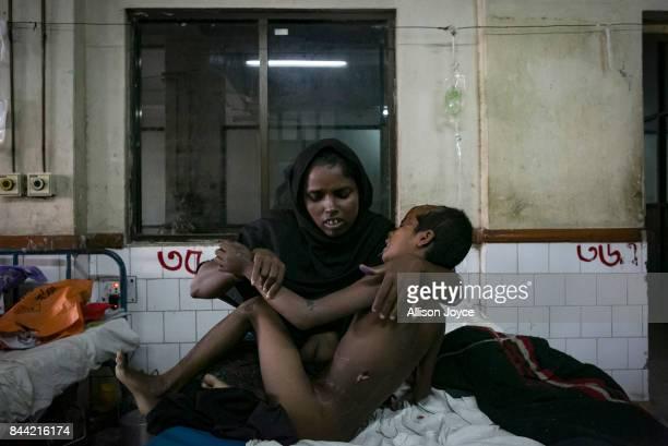 Nur Aysha holds her daughter 8 year old Jubaira in Chittagong Medical College Hospital September 8 2017 in Chittagong Bangladesh Jubaira was involved...