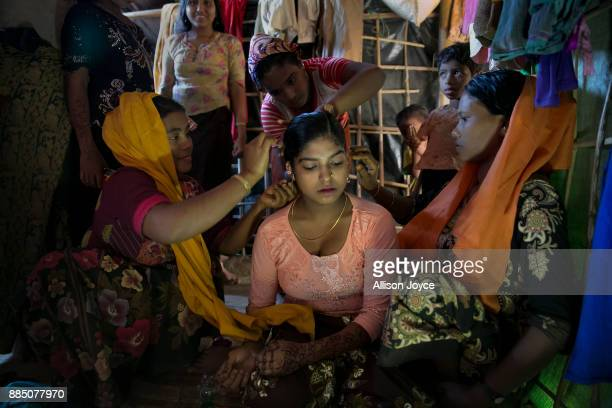 COX'S BAZAR BANGLADESH NOVEMBER 30 Nur Begum who doesn't know her age but thinks she is between 14 and 16 years old has her hair done on the day of...