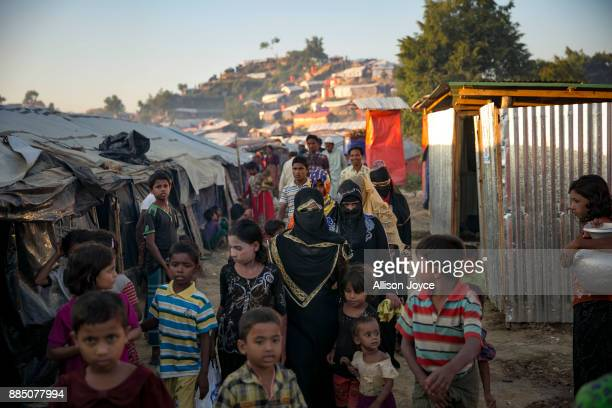 COX'S BAZAR BANGLADESH NOVEMBER 30 Nur Begum who doesn't know her age but thinks she is between 14 and 16 years old walks to her husband's house with...
