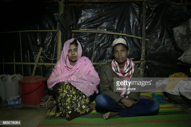 COX'S BAZAR BANGLADESH NOVEMBER 30 Nur Begum who doesn't know her age but thinks she is between 14 and 16 years old poses for photo with her new...
