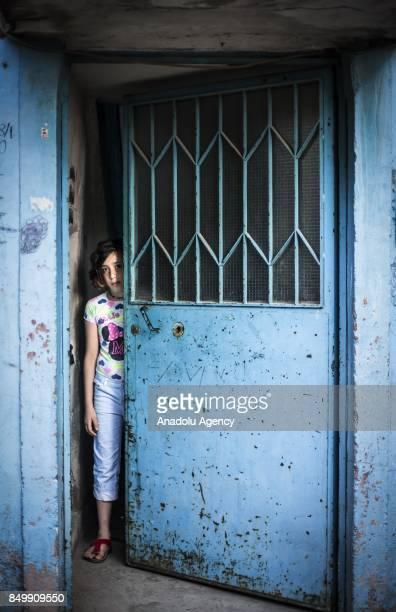Nur Hatir looks behind of a half way open door in Altindag district of Ankara Turkey on July 26 2017 Nur Hatir's father was taken and killed in Syria...