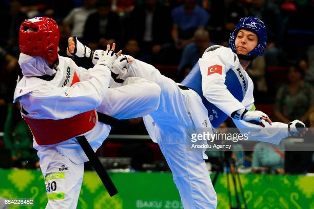 Nur Tatar of Turkey and Juylana AlSadeq of Jordan compete in the Womens 67kg Taekwondo SemiFinal during day six of the 4th Islamic Solidarity Games...