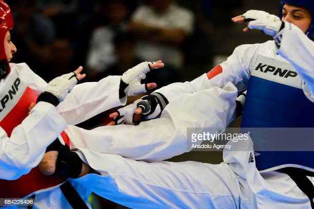 Nur Tatar of Turkey and Juylana AlSadeq of Jordan compete in the Womens 67kg Taekwondo SemiFinal during day six of the 4th Islamic Solidarity Games...