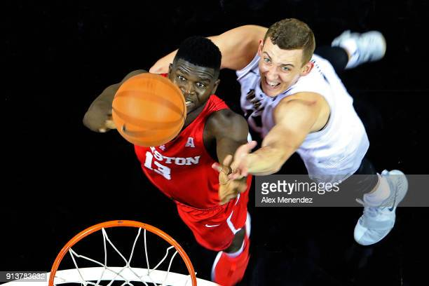 Nura Zanna of the Houston Cougars and Rokas Ulvydas of the UCF Knights fight for a rebound during a NCAA basketball game at the CFE Arena on February...