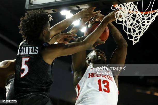Nura Zanna of the Houston Cougars attempts a shot defended by Jalen McDaniels of the San Diego State Aztecs during the second half of the first round...