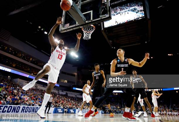 Nura Zanna of the Houston Cougars attempts to save the ball from going out against Trey Kell of the San Diego State Aztecs during the second half of...