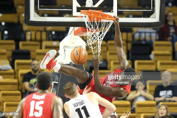 Nura Zanna of the Houston Cougars gets fouled on a rebound attempt by Rokas Ulvydas of the UCF Knights during a NCAA basketball game at the CFE Arena...