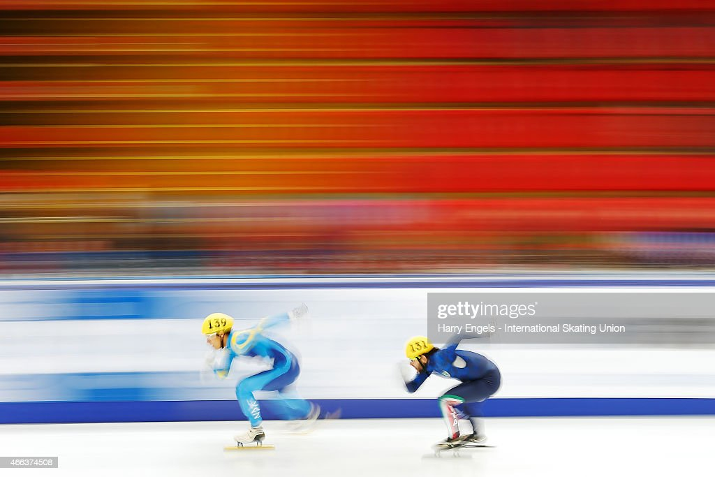 Nurbergen Zhumagaziyev of Kazakhstan (L) leads Yuri Confortola of Italy during the Men's 1000m RR Heats on day three of the ISU World Short Track Speed Skating Championships at the Krylatskoe Speed Skating Centre on March 15, 2015 in Moscow, Russia.