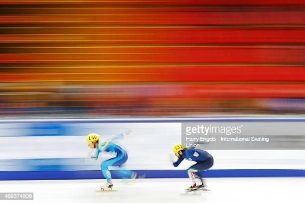 Nurbergen Zhumagaziyev of Kazakhstan leads Yuri Confortola of Italy during the Men's 1000m RR Heats on day three of the ISU World Short Track Speed...