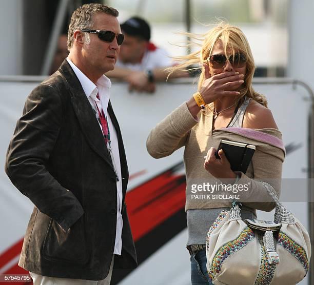 Former German olympic swimming champion Franziska van Almsick and her boyfriend Juergen BHarder walk on the paddock of the Nurburgring racetrack...