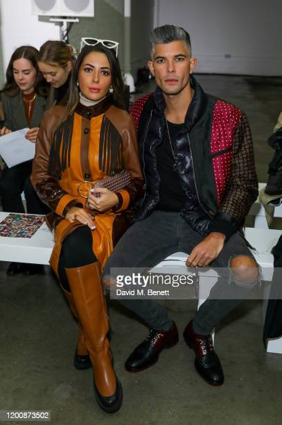 Nurce Erben and Rayer Van Ristell attend the Marques'Almeida show during London Fashion Week February 2020 at The Old Truman Brewery on February 15...
