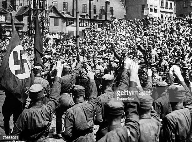 Nuremberg Germany 20th September 1930 Nazi leader Adolf Hitler is cheered by thousands of frantically enthusiastic supporters giving the Nazi salute...