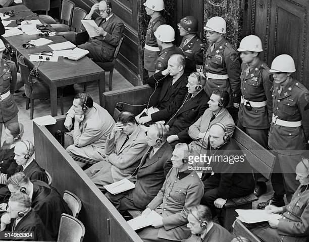 Here are shown the defendants in the Nuremberg War Criminals Trial as they sit in various attitudes during the phases of the legal manoeuvering Left...